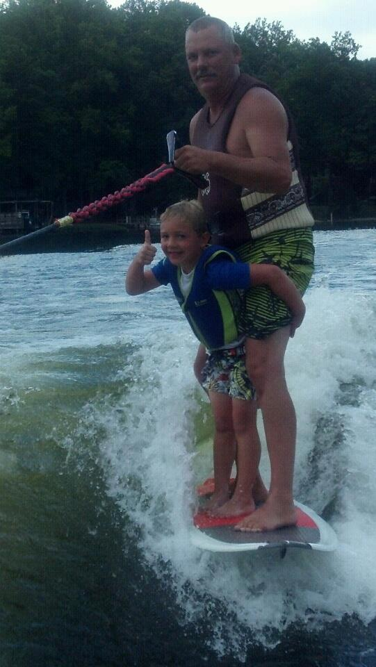 Jeff Scott wakesurfing with his grandson.