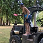 Massi with the tractor hole playing disc golf